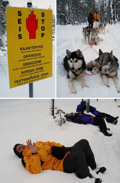 Sign near the Russian border; P & his team; exhausted P taking a break (even tho the dogs shd be the ones who are tired)